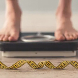 man on weighing scale