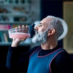 man drinking shake