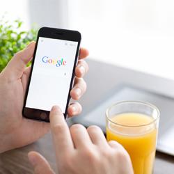 man googling drink